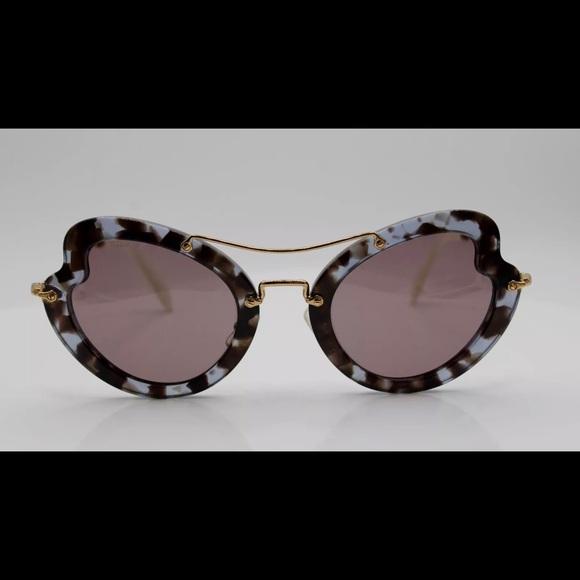 90dd71ce9ac Authentic Miu Miu Stunning sunglasses EUC w case.  M 5b72a9531299550966feedff. Other Accessories ...